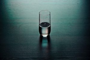 A glass sits on the table begging the question is it half empty or half full? The importance of perception is all about how you answer this question.