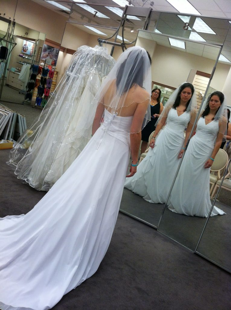 A woman with adrenal insufficiency no longer has the strength to smile while modeling her wedding dress.