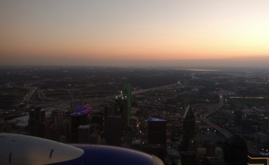 Dallas Skyline at dusk as viewed from the window of an airplane.