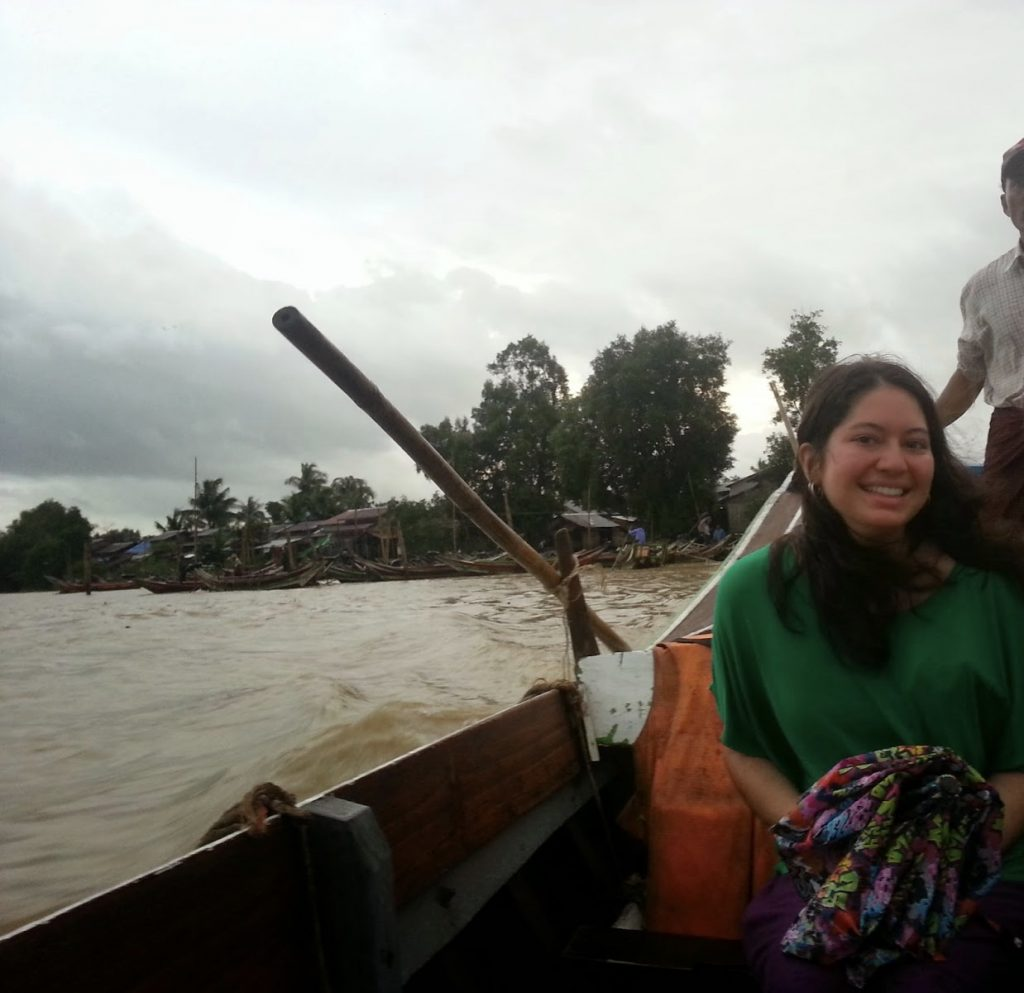 Amber Nicole on a small boat crossing the river in order to deliver her speech about living Clearly Alive.