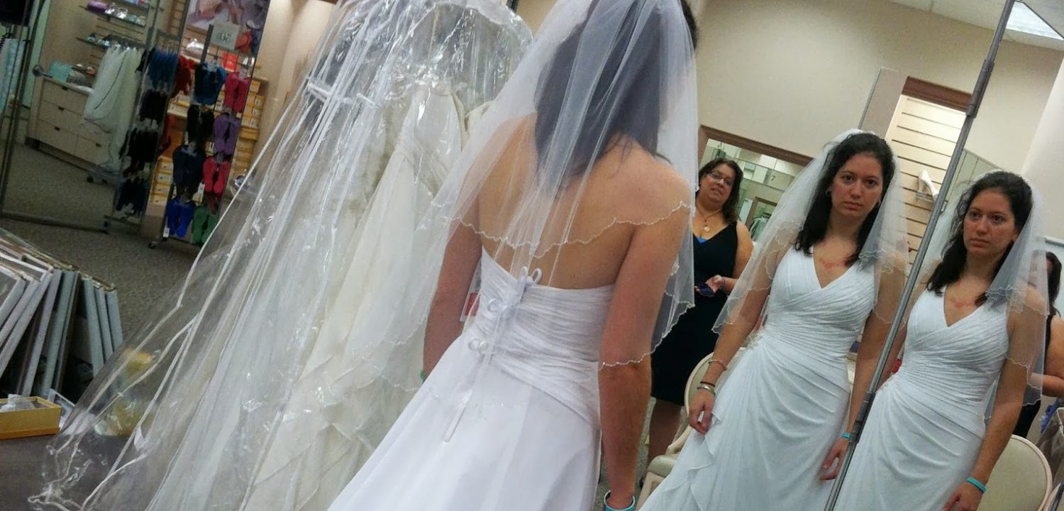 A woman with adrenal insufficiency does not have the strength to smile even though he should be happy while she tries on her wedding dress.