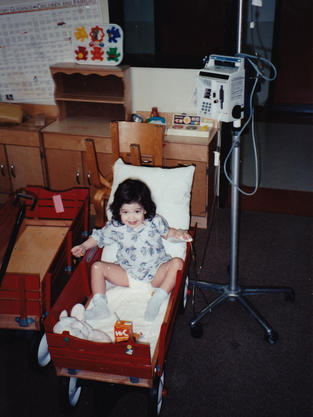 A child with adrenal insufficiency smiles although she is in the hospital.