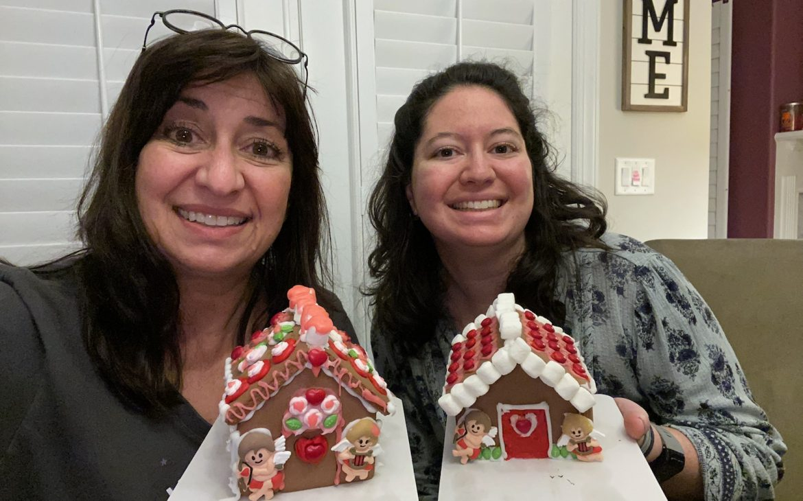 February 2020 Recap: Mother and daughter displaying Valentine's Day Gingerbread houses