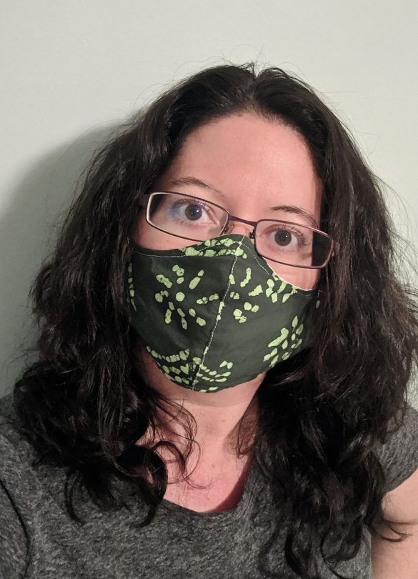 Woman wearing a homemade green cloth face covering.
